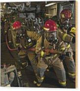 Firemen Combat A Simulated Fire Aboard Wood Print