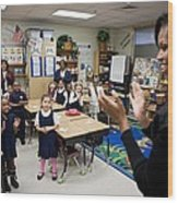 First Lady Michelle Obama Claps Wood Print by Everett