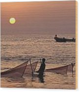 Fishermen Holding Nets In Sea At Sunset Wood Print