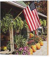 Flag Among The Pumpkins Wood Print