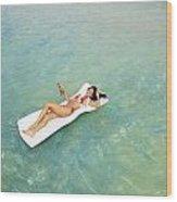 Floating At Sea Wood Print