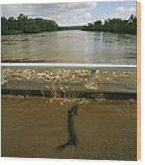 Flood Waters Rise To Meet A Bridge Wood Print by Randy Olson