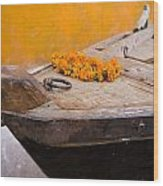 Flowers On Top Of Wooden Canoe Wood Print