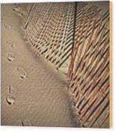 Footprints On The Beach Along A Fence Wood Print