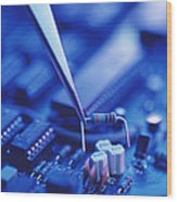 Forceps Holding A Resistor Over A Circuit Board Wood Print