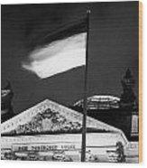 german flag flying fluttering on flagpole outside reichstag building Berlin Germany Wood Print by Joe Fox