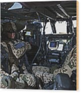 German Soldiers Seated In A Uh-60l Wood Print