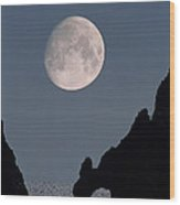 Gibbous Moon Rising Over A Coastal Cliff Wood Print
