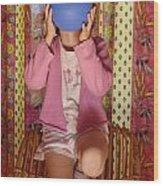 Girl Blowing Up Balloon Wood Print