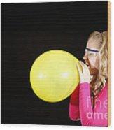 Girl Inflating Balloon Wood Print