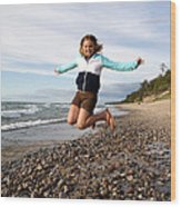 Girl Jumping At Lake Superior Shore Wood Print