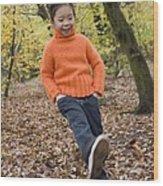 Girl Kicking Leaves Wood Print