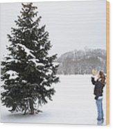 Girl Measuring Tree Height Wood Print
