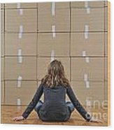Girl Seated In Front Of Cardboard Boxes Wood Print