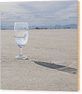 Glass Of Water On Dried Mud Wood Print by Thom Gourley/Flatbread Images, LLC