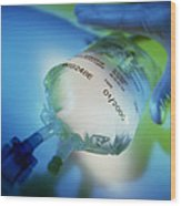 Gloved Hand Reaches For An Intravenous Drip Bag Wood Print
