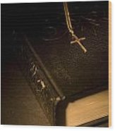 Gold Cross Pendant Resting On A Book Wood Print by Philippe Widling