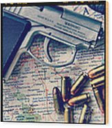 Gun And Bullets On Map Wood Print