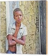 Haitien Boy Leaning On Wall Wood Print