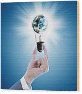 Hand Holding Light Bulb With Globe  Wood Print