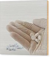 Hand With Pills Wood Print