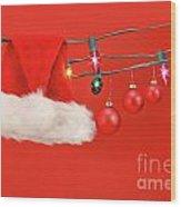 Hanging Lights With Santa Hat Wood Print