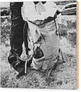 hiker hillwalker packing rucksack before going hiking in the highlands of Scotland UK Wood Print