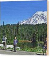 Hikers At Reflection Lake Wood Print