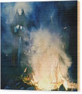 Hooded Figure In A Mask By A Fire Wood Print