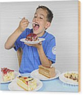 Hungry Boy Eating Lot Of Cake Wood Print