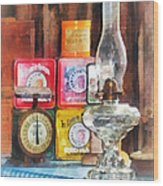 Hurricane Lamp And Scale Wood Print by Susan Savad