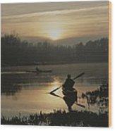 Kayakers Paddle Through Still Water Wood Print
