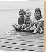 Kids Sitting On Dock Wood Print