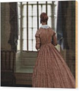 Lady In 19th Century Clothing Looking Out Window Wood Print