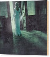 Lady In White Gown Walking Through A Mysterious Doorway Wood Print
