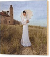 Lady In White With Parasol By The Sea Wood Print