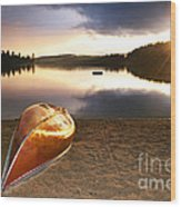 Lake Sunset With Canoe On Beach Wood Print by Elena Elisseeva