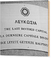 last divided city sign next to the crossing point on ledra street of the UN buffer zone Wood Print