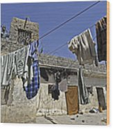 Laundry Hangs In The Courtyard Wood Print by Stocktrek Images
