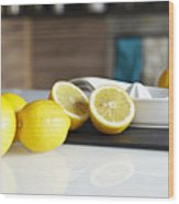 Lemons And Juicer On Kitchen Counter Wood Print