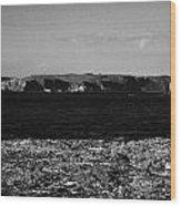 Lifebelt On Rocks At Ballintoy With Moyle Sea And Rathlin Island Wood Print by Joe Fox