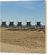 Lifeguard Stand's On The Beach Wood Print
