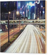 Light Trails At Traffic On Street At Night Wood Print