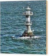 Lighthouse On The Blue Sea Wood Print