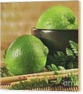 Limes With Chopsticks Wood Print by Sandra Cunningham