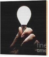 Lit Lightbulb Held In Hand Wood Print