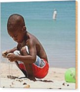 Little Boy Playing With Sand On The Beach Wood Print