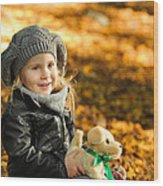 Little Girl In Autumn Leaves Wood Print
