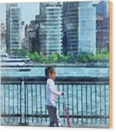 Little Girl On Scooter By Manhattan Skyline Wood Print