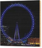 London Eye All Done Up In Blue Light In The Night With A Small Reflection In The Thames Wood Print
